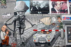 Berlin Wall with Checkpoint Charlie. Berlin wall dividing east and west Germany royalty free stock image