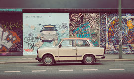 Berlin Wall at East Side Gallery with Trabant car, Germany Royalty Free Stock Images