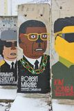 Berlin Wall element. Part of Berlin Wall. Part of wall standing in backyard to Zimmerstrasse.  This illustration shows Robert Mugabe, President of Zimbabwe Royalty Free Stock Image