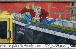 Berlin wall. Berlin, Germany - April 28th, 2015: Paintings on the Berlin Wall in the East Side Gallery Royalty Free Stock Photo