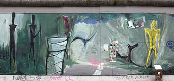 Berlin wall. Berlin, Germany - April 28th, 2015: Paintings on the Berlin Wall in the East Side Gallery Stock Photography