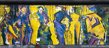 Berlin wall. Berlin, Germany - April 28th, 2015: Paintings on the Berlin Wall in the East Side Gallery Royalty Free Stock Photos