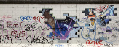 Berlin wall. Berlin, Germany - April 28th, 2015: Paintings on the Berlin Wall in the East Side Gallery Stock Photo