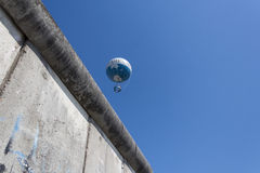 The berlin wall and hot air balloon (highflyer/ hiflyer)) Royalty Free Stock Photo