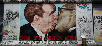 Berlin Wall mural at East Side Gallery. My God, Help Me to Survive This Deadly Love mural at the Berlin Wall East Side Gallery in Germany depicting a kissing Stock Photography