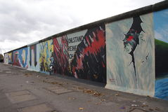 Berlin Wall overview. Part of the remaining berlin wall with gravity art royalty free stock photos
