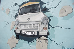 Free Berlin Wall Painting With &x22;Trabbi&x22;, Trabant Car, Breaking The Wall Down.  Royalty Free Stock Images - 76891759