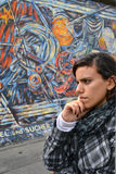 Berlin wall - tourist looking at the art royalty free stock photography