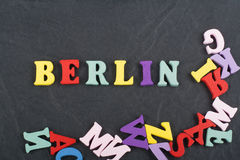 BERLIN word on black board background composed from colorful abc alphabet block wooden letters, copy space for ad text Royalty Free Stock Photography