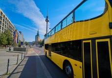 Berlin yellow tourist bus near Berliner Dom. In Germany Stock Photo