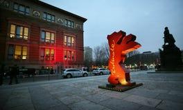 A Berlinale bear figure is seen as people Stock Photos