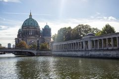 Berliner Dom, cathedral church on island museum in Berlin, Germany. Bridge in front, blue sky background stock images