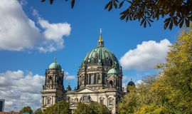 Berliner Dom, cathedral church on island museum in Berlin, Germany. Top part of monument and blue sky background. Berliner Dom, cathedral church on island museum royalty free stock photo