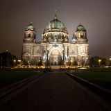 The Berliner Dom at Night (& TV Tower). A view of the Berliner Dom and the TV Tower in the distance.  At night in Berlin Stock Photography