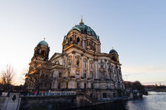 Berliner Dom at sunrise. The Berliner Dom & x28;main church in the German capital& x29;, seen from across the Spree river Stock Photos