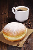 Berliner donut with coffee Stock Photos