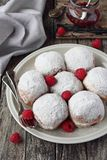 Berliner ( donuts ) with raspberry and jam filling Stock Images