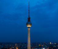 Berliner Fernsehturm IV. A picture of the Berliner Fernsehturm taken at night from the building in front of it Royalty Free Stock Photos
