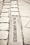 Berliner wall cobblestone run Royalty Free Stock Photo