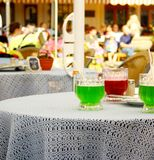Berliner Weisse, green and red cocktail with straw Royalty Free Stock Images