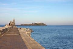 Bermeo.Izaro Island. The breakwater of Bermeo (Biscay) with Izaro Island in the background Royalty Free Stock Images
