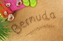 Bermuda beach. Background with palm leaves, towel and flip flops Stock Photography