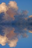 Bermuda Peace. Amazing tropical clouds and their reflection in very still water Stock Images