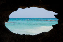 Bermuda sea. View of the sea in Bermuda through a hole in a rock stock photography