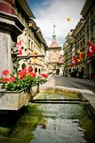 Bern. One of the main and old streets of Bern with old Fountain on foreground Stock Photography