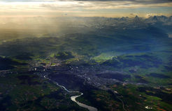 Bern and Alps aerial view. View from plane, at high altitude, of the Wholensee, the city of Bern and the Alps in the background. Image taken 04/28/2012 stock images