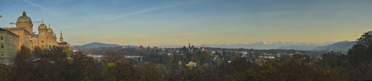 Bern city and Federal Palace of Switzerland (Bundesplatz) with Swiss alps on sunset. Stock Photos