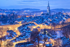Bern Old Town snow covered in winter, Switzerland. Old Town of Bern, capital of Switzerland, covered with white snow in the evening blue hour stock photos