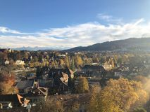 A view over the capital of Switzerland Bern on a sunny autumn day. Bern panorama with mountains in the background stock photography