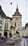 Bern Prison Tower with a red street car Royalty Free Stock Image