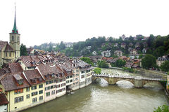 Bern's old town from Nydeggbruecke. Bern's quaint Old Town, a UNESCO World Cultural Heritage Site, is framed by the Aare river and Royalty Free Stock Photo