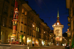 Bern street in night time. With the clock from the main road and one of the famous statue Stock Photo