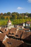 Bern Switzerland. Looking over old rooftops onto the hills full of autumn color Stock Photos