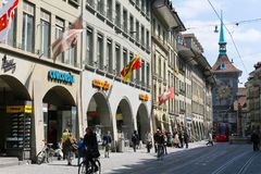 City life among historical buildings. Bern, Switzerland - April 20, 2017: City life among historical buildings. This is a street view of the old town with tram Royalty Free Stock Photos