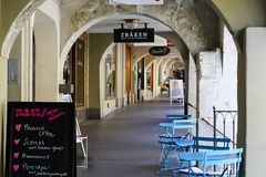 The pathway under arcades in Bern. Bern, Switzerland - April 20, 2017: The pathway under the arcades. Arcades of the Old Town are one of the many tourist Royalty Free Stock Photo