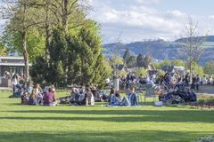 People relaxing at Rosengarten, The rose garden is a park northeast of the old town of Bern . Bern, Switzerland - April 14,2017 : People relaxing at Rosengarten Stock Image