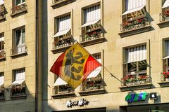 Flag of Bern canton waving street in city center. Bern, Switzerland - August 31, 2016: Flag of Bern canton waving in street in city center royalty free stock images