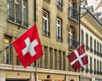 Swiss Flags waving street at the city center Bern. Bern, Switzerland - August 31, 2016: Swiss Flags waving in the street in the old city center of Bern stock photo
