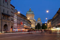 Bern, Switzerland. Barenplatz, with the Swiss Parliament Building looming over the square in Bern, Switzerland at night time stock photography