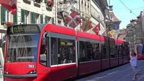BERN, SWITZERLAND - JULY 06, 2017: Colorful trams at Kramgasse in Bern, Switzerland. Kramgasse is part of the World stock footage