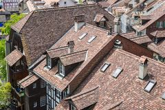 Medieval tiled roof. Old tiling texture. Stock Photo