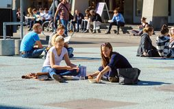 Bern, Switzerland - October 17, 2017: A group of students are ha. Ving lunch, seating in the town square stock photos