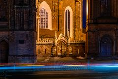 Bernardine Church with gate and bell tower and St. Anne`s Church at winter night, in Vilnius royalty free stock photos