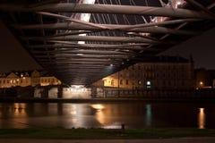 Bernatka Bridge in Krakow. A night shot of the Bernatka Bridge that crosses the Vistula River connecting the districts of Kazimirze and Podgurze in Krakow Stock Images