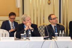 Bernd Braasch and Eduardo Borensztein. MOSCOW, RUSSIA - FEB 15: Bernd Braasch Director financial stability department Deutsche Bundesbank and Eduardo Borensztein royalty free stock image