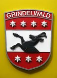 Berner Oberland, Shield 01. The shield for the town on Grindelwald on a train in the Burner (Bernese) Oberland area of central Switzerland Royalty Free Stock Image